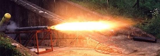 The B4 hybrid rocket motor being static test fired - June 2002